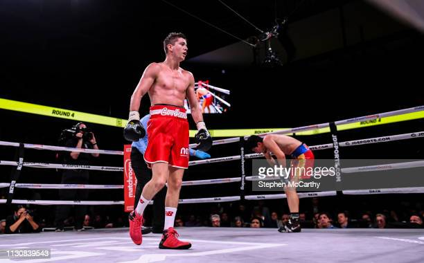 Pennsylvania , United States - 15 March 2019; Luke Campbell, left, walks to the neutral corner as Adrian Yung is given a count by referee Eric Dali...