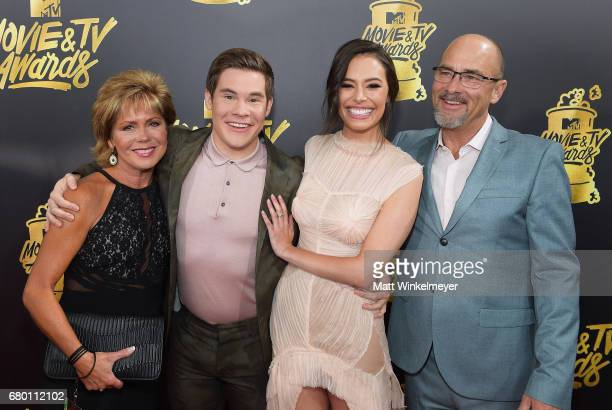 Penny DeVine host Adam DeVine Chloe Bridges and Dennis DeVine attend the 2017 MTV Movie And TV Awards at The Shrine Auditorium on May 7 2017 in Los...