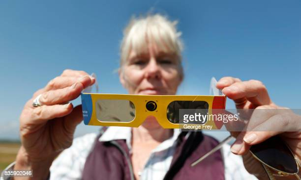 Penny FarsterNarlesky from Denver Colorado looks at her solar eclipse glasses at a roadside information center in Grand Teton National Park on August...