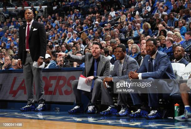 Penny Hardaway head coach of the Memphis Tigers Mike Miller Tony Madlock and Sam Mitchell assistant coaches of the Memphis Tigers on the sideline...