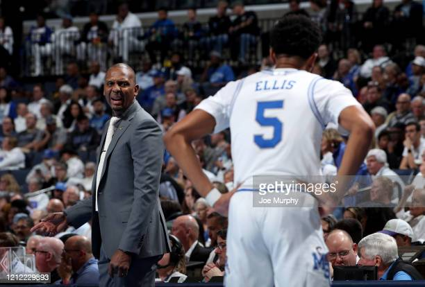 Penny Hardaway head coach of the Memphis Tigers talks with Boogie Ellis of the Memphis Tigers against the Wichita State Shockers during a game on...