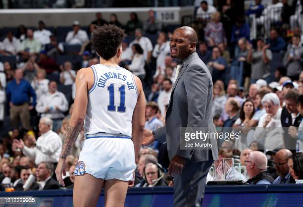Penny Hardaway head coach of the Memphis Tigers talks with lester Quinones of the Memphis Tigers against the Wichita State Shockers during a game on...