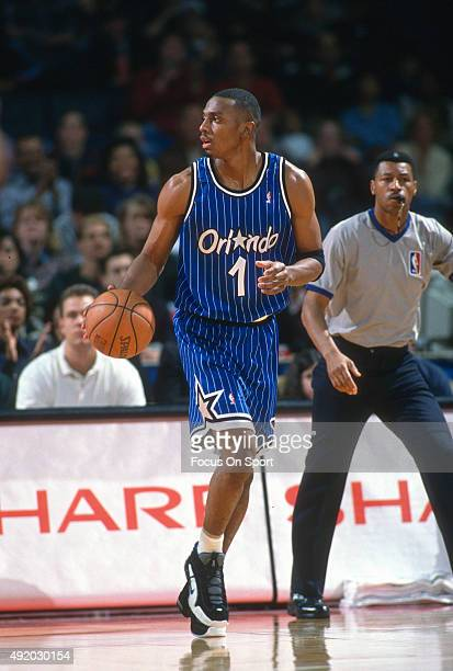 Penny Hardaway of the Orlando Magic dribbles the ball against the Washington Bullets during an NBA basketball game circa 1997 at US Airways Arena in...