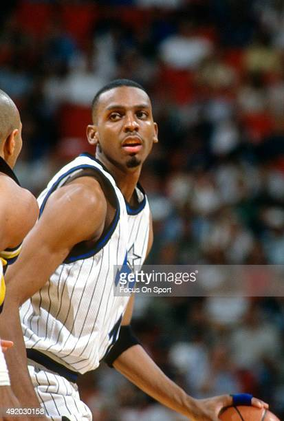 Penny Hardaway of the Orlando Magic dribbles the ball against the Indiana Pacers during an NBA basketball game circa 1995 at the Orlando Arena in...