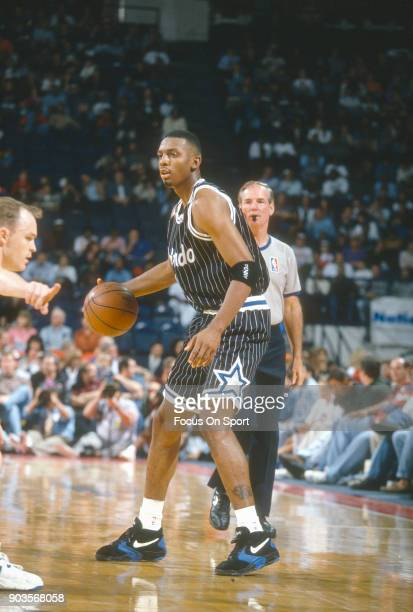 Penny Hardaway of the Orlando Magic dribbles the ball against the Washington Bullets during an NBA basketball game circa 1994 at the US Airways Arena...