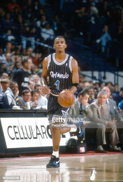 Penny Hardaway of the Orlando Magic dribbles the ball up court against the Washington Bullets during an NBA basketball game circa 1994 at the US...