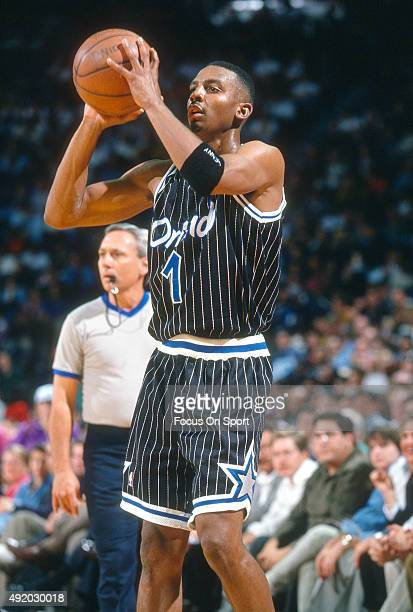 Penny Hardaway of the Orlando Magic looks to pass the ball against the Washington Bullets during an NBA basketball game circa 1994 at US Airways...