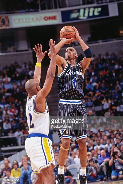 Penny Hardaway of the Orlando Magic shoots against the Golden State Warriors on March 7 1997 at the Arena in Oakland in Oakland California NOTE TO...