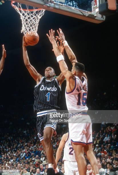 Penny Hardaway of the Orlando Magic shoots over Kenny Walker of the Washington Bullets during an NBA basketball game circa 1994 at the US Airways...