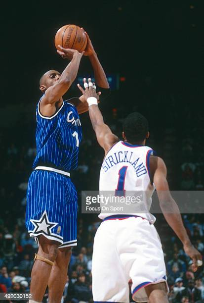 Penny Hardaway of the Orlando Magic shoots over Rod Strickland of the Washington Bullets during an NBA basketball game circa 1997 at US Airways Arena...