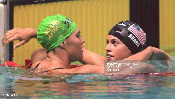 Penny Heyns of South Africa is hugged by 14yearold Amanda Beard of the US following Heyn's Olympic gold medal victory in the women's 100m...