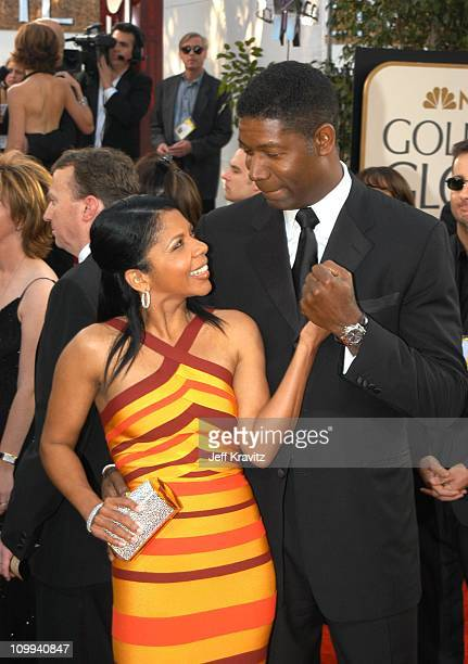 Penny Johnson and Dennis Haysbert during The 60th Annual Golden Globe Awards - Arrivals at Beverly Hilton Hotel in Beverly Hills, CA, United States.