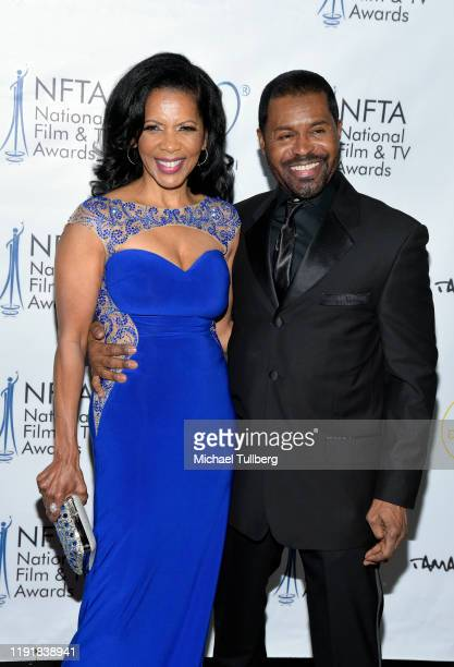 Penny Johnson Jerald and Gralin Jerald attend the 2nd annual National Film and TV Awards at Globe Theatre on December 03, 2019 in Los Angeles,...