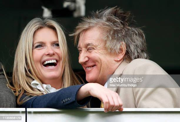 Penny Lancaster and Sir Rod Stewart watch the racing as they attend day 3 'St Patrick's Thursday' of the Cheltenham Festival at Cheltenham Racecourse...