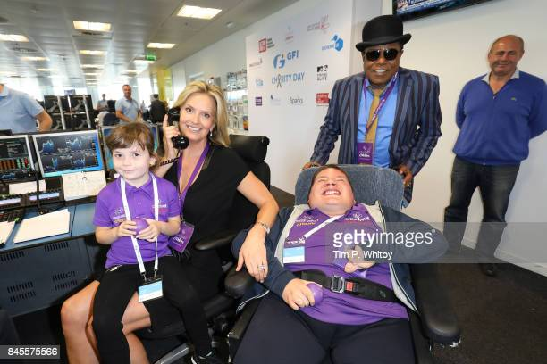 Penny Lancaster with Tito Jackson representing CaudwellÊmakes a trade at GFI Charity Day 2017 on September 11 2017 in London England