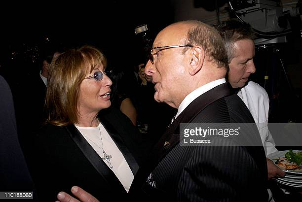 Penny Marshall and Clive Davis during 2004 Clive Davis PreGrammy Party Backstage and Audience at Beverly Hills Hotel in Beverly Hills California...