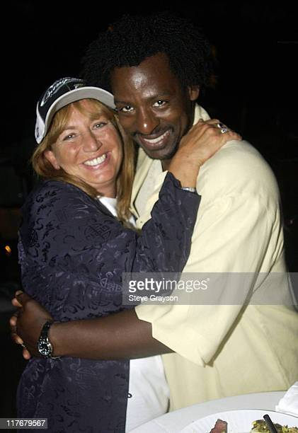 Penny Marshall Ron Finley pose for photographers at the Los Angeles Lakers victory celebration at Ian Schrager's Ultra Chic Mondrian Hotel