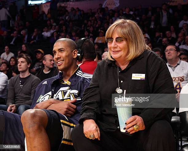 Penny Marshall talks to Raja Bell at a game between the Utah Jazz and the Los Angeles Lakers at Staples Center on January 25 2011 in Los Angeles...