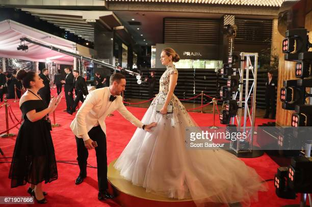 Penny McNamee has her dress adjusted as she arrives at the 59th Annual Logie Awards at Crown Palladium on April 23 2017 in Melbourne Australia