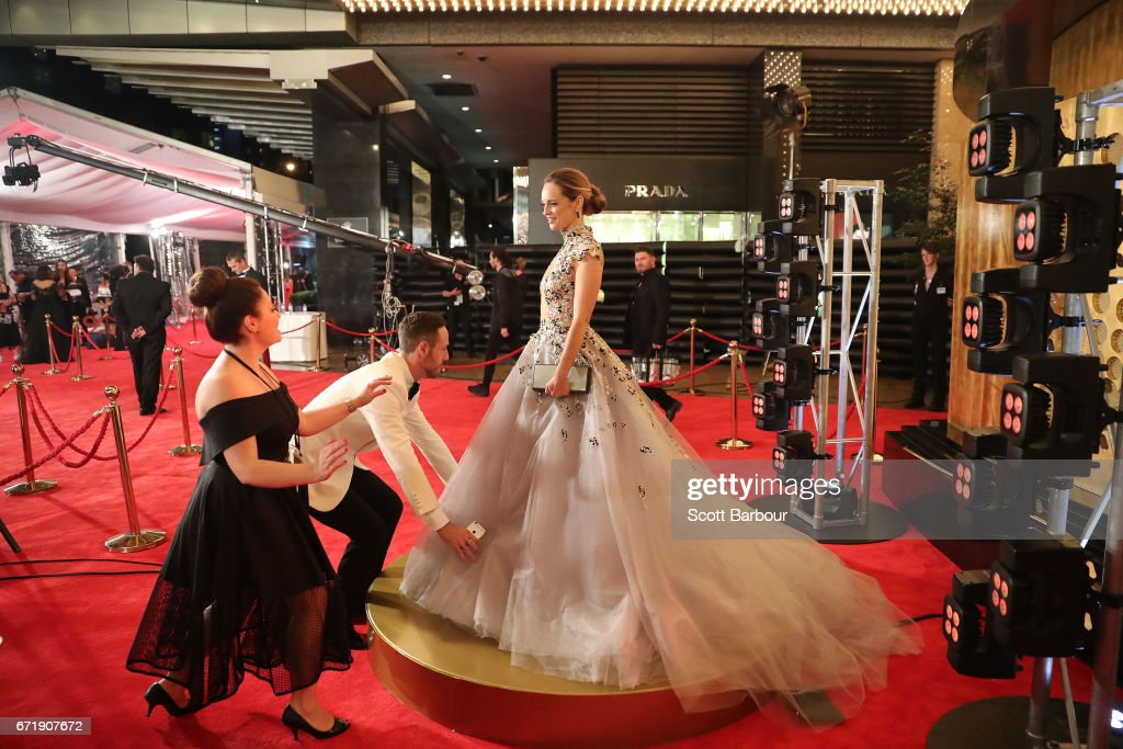 Penny McNamee has her dress adjusted as she arrives at the 59th Annual Logie Awards at Crown Palladium on April 23, 2017 in Melbourne, Australia.
