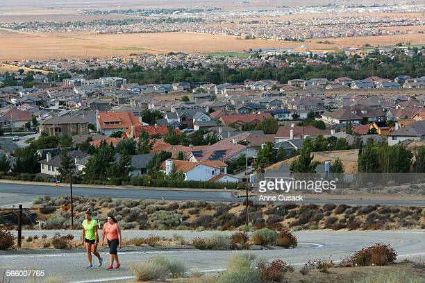 Penny Munz left walks with her daughter Stephanie Munz right in Palmdale as Palmdale is in the foreground and Lancaster can be seen in the distance...