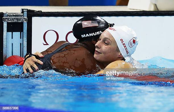 Penny Oleksiak of Canada and Simone Manuel of United States hug after the final of the Women's 100m Freestyle on Day 6 of the Rio 2016 Olympic Games...