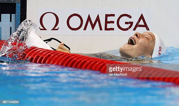 Penny Oleksiak of Canada elebrates after she wins silver in the Women's 100m Butterfly final during Day 2 of the Rio 2016 Olympic Games at Olympic...