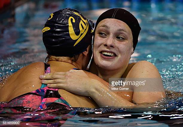 Penny Oleksiak of Canada hugs Dana Vollmer after winning the women's 100m freestyle during the 2016 Arena Pro Swim Series at Charlotte swim meet at...