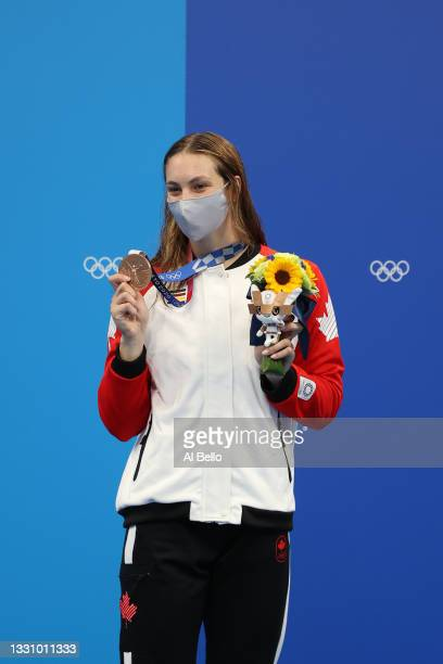 Penny Oleksiak of Team Canada poses with the bronze medal for Women's 200m Freestyle Final on day five of the Tokyo 2020 Olympic Games at Tokyo...