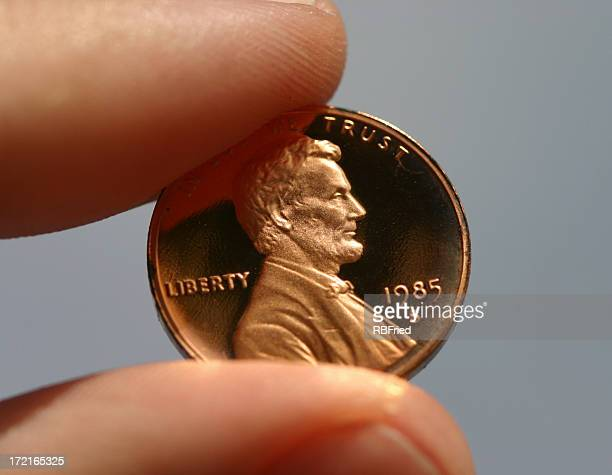 penny pinched - us penny stock pictures, royalty-free photos & images