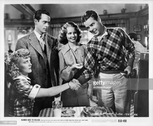 Penny Singleton and Arthur Lake shake hands in a scene from the film 'Blondie Goes To College' 1942