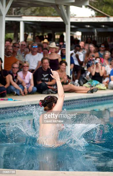 Penny Star Jr jumps into the pool during her performance at the Miss Exotic World Pageant at the Exotic World Burlesque Museum on June 7 2003 in...