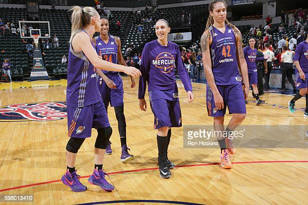 Penny Taylor DeWanna Bonner Diana Taurasi and Brittney Griner of the Phoenix Mercury celebrate a win against the Indiana Fever on August 30 2016 at...