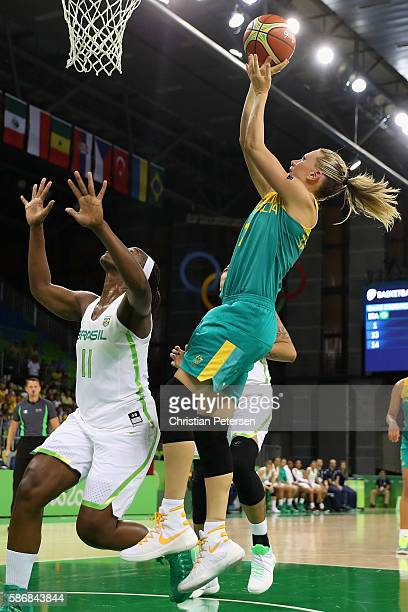 Penny Taylor of Australia attempts a shot against Clarissa Santos of Brazil during a Women's Basketball Preliminary Round game on Day 1 of the Rio...