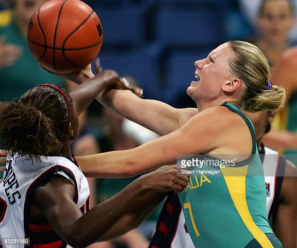 Penny Taylor of Australia drives to the net against Sheryl Swoopes of USA in the gold medal in the women's basketball gold medal match between United...