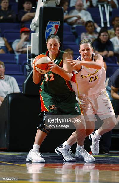 Penny Taylor of the Phoenix Mercury defends Adia Barnes of the Seattle Storm during the WNBA preseason game at America West Arena on May 5 2004 in...