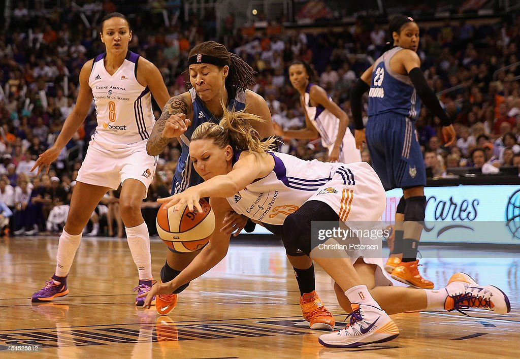 Penny Taylor #13 of the Phoenix Mercury dives for a loose ball with Seimone Augustus #33 of the Minnesota Lynx during game three of the WNBA Western Conference Finals at US Airways Center on September 2, 2014 in Phoenix, Arizona. The Mercury defeated the Lynx 96-78.