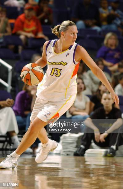Penny Taylor of the Phoenix Mercury dribbles against the San Antonio Silver Stars during the game at America West Arena on July 21 2004 in Phoenix...