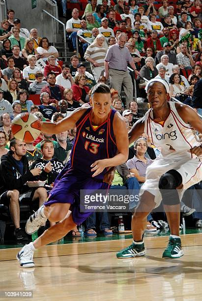 Penny Taylor of the Phoenix Mercury drives against Swin Cash of the Seattle Storm in Game One of the Western Conference Finals during the 2010 WNBA...