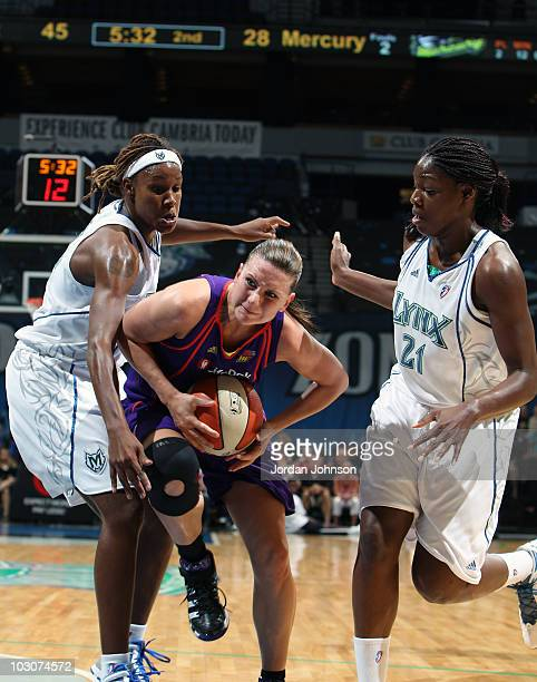 Penny Taylor of the Phoenix Mercury drives down the lane against Rebekkah Brunson and Nicky Anosike pf the Minnesota Lynx during the game on July 24...