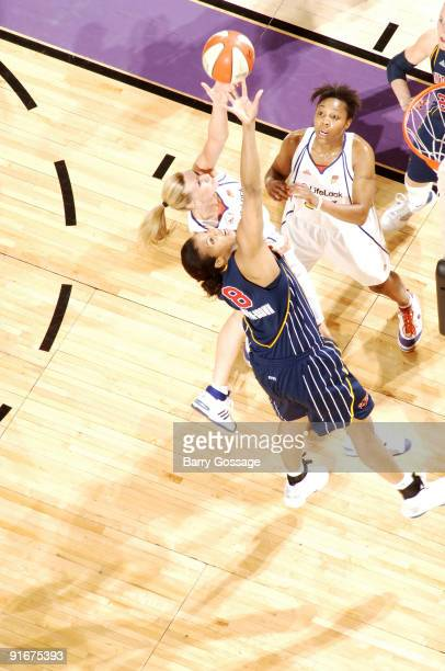 Penny Taylor of the Phoenix Mercury fights for a rebound with Tammy SuttonBrown of the Indiana Fever in Game five of the WNBA Finals played on...