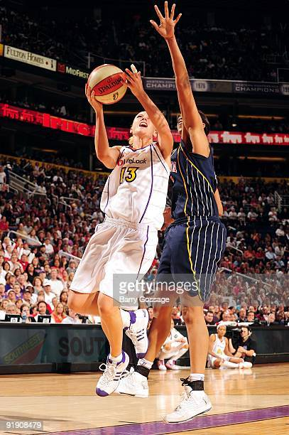 Penny Taylor of the Phoenix Mercury goes up for a shot against Tammy SuttonBrown of the Indiana Fever in Game Five of the WNBA Finals at US Airways...