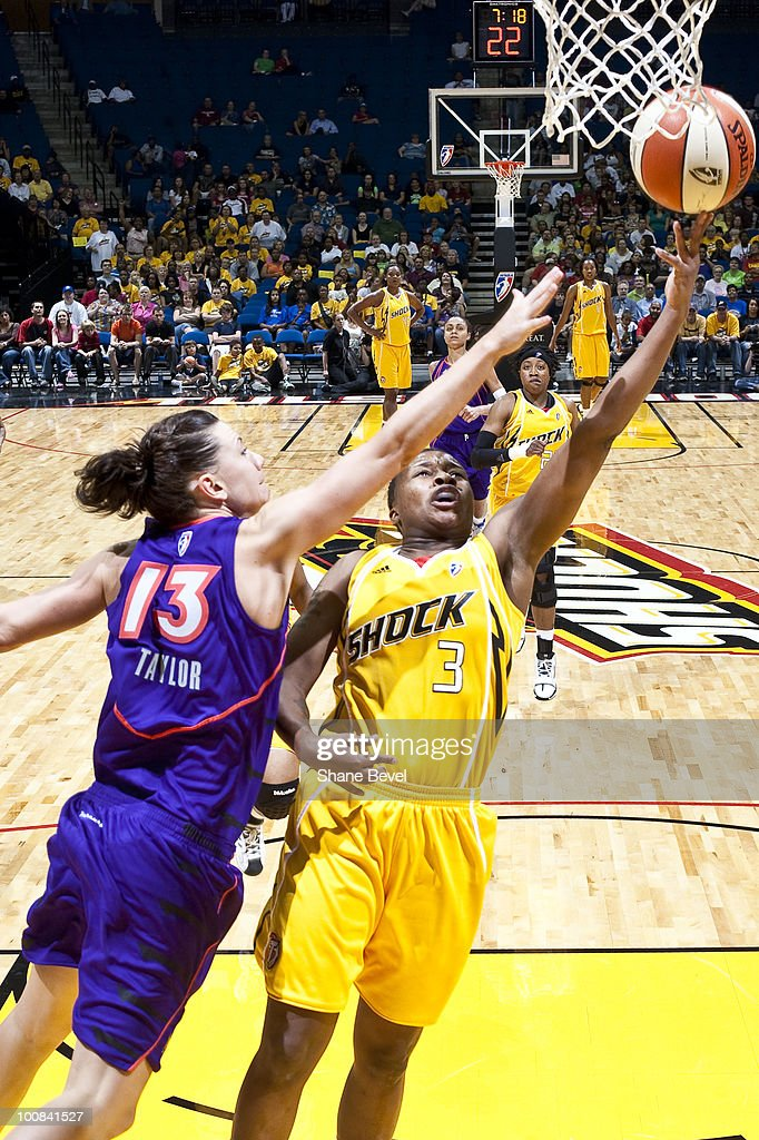 Penny Taylor #13 of the Phoenix Mercury tries to block a shot by Natasha Lacy #3 of the Tulsa Shock during the WNBA game on May 25, 2010 at the BOK Center in Tulsa, Oklahoma.