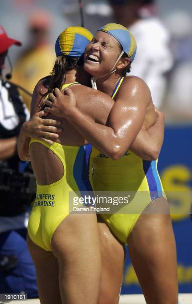 Penny Turner and Karla Gilbert of Surfers Paradise Surf Life Saving Club celebrate winning the Women's Board Rescue race during the 2003 Australian...
