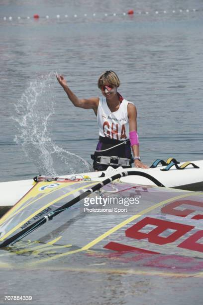 Penny Way of the Great Britain team flicks water over her sailboard during competition to finish in 6th place in the Women's Lechner A390 sailboard...
