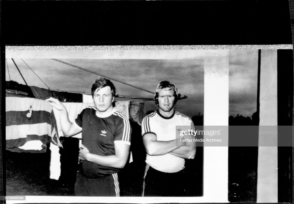 Penrith footballers Ken Bousfield and Ross Cale hang up John Farragher's training jersey at the clothesline of their Cranebrook home today. Farragher last night told these two team mates that he would be getting out of his hospital bed and would be back o : News Photo