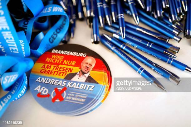 Pens and stickers bearing a portrait of Andreas Kalbitz, top candidate of the far-right AfD party for state elections in Brandenburg, are displayed...