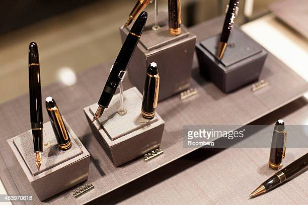 Pens are display for sale inside the Montblanc store at the Village Mall in Rio de Janeiro Brazil on Wednesday Aug 12 2015 Cartier and Louis Vuitton...