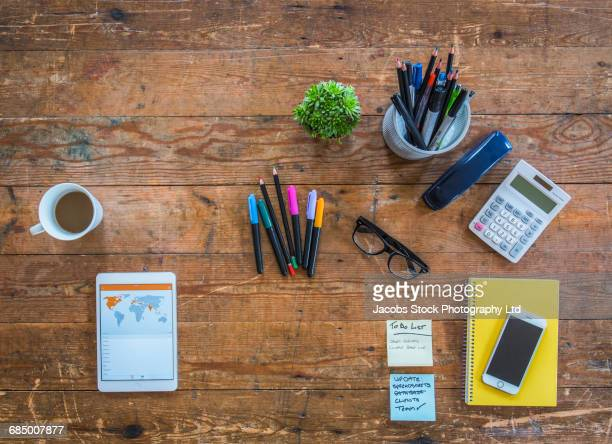 pens, technology and coffee on wooden table - contact list stock photos and pictures