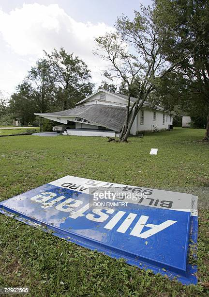 TO GO WITH AFP STORY USinsuranceweatherAllstateStateFarm In this 11 July 2005 file photo A collapsed Allstate Insurance office is seen after...
